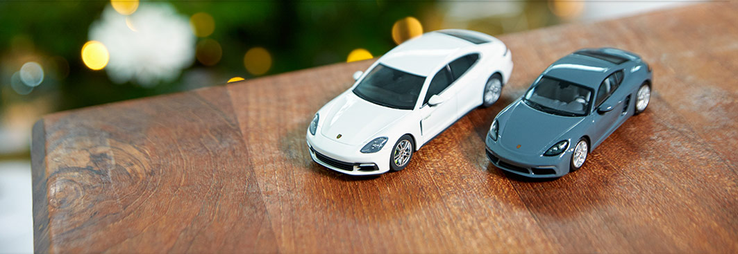 Home - Porsche 718 Cayman (982), Graphite Blue Metallic, 1:43